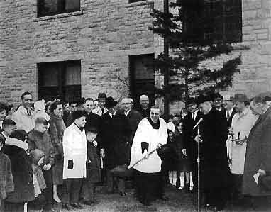 Fr. Wernert surrounded by retreatants, breaks ground for the new wing in 1966